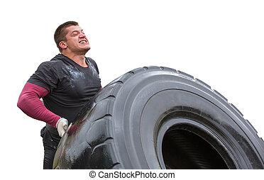 sportsman can hardly lift a car tire on an isolated...