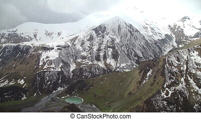 Aerial view of blue lake surrounded by mountains