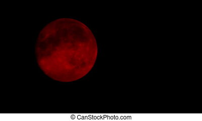Red Moon On Cloudy Night Closeup - Closeup of red moon in...
