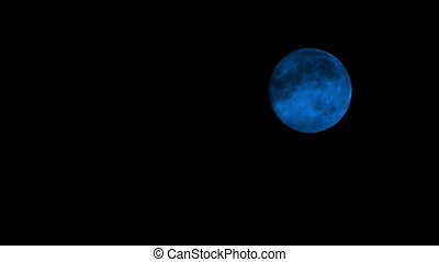 Blue Moon On Cloudy Night - Blue moon in the night sky