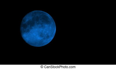 Blue Moon On Cloudy Night Closeup - Closeup of blue moon in...