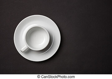 Empty white cup for espresso with saucer on black...