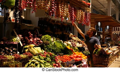 man choose vegetables at the market