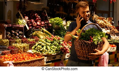 Man with big basket talking on the phone