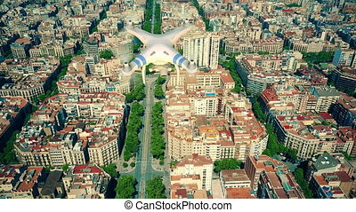Aerial view of drone flying and filming above Barcelona...