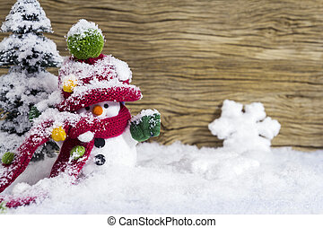 Christmas decoration happy snowman standing in winter