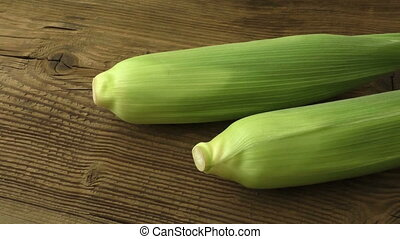 Cobs fresh corn on old wooden surface, closeup, top view