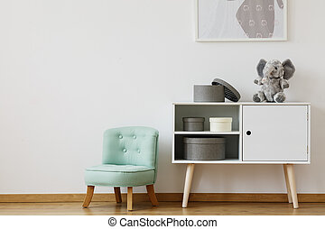 Cupboard and mint chair - Bright cupboard standing next to...