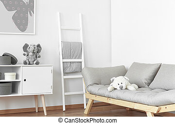 White and grey room - Two fluffy stuffed animals in the...