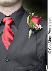 Man Wearing Formal Suit Tie and Flower