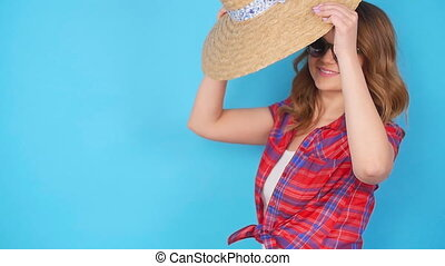 Young woman posing on blue background in studio - Young girl...