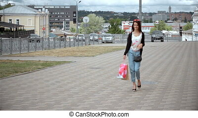 beautiful young girl walking down the street