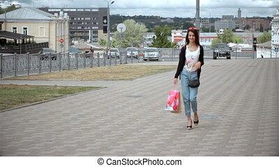 beautiful young girl walking down the street
