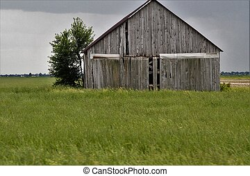 Old grey barn in rural countryside