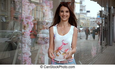 attractive happy girl with shopping in the hands