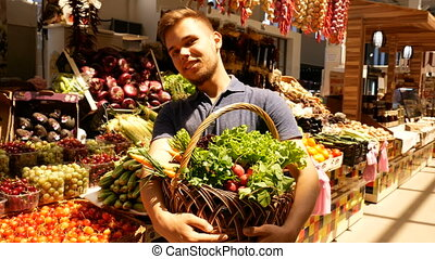 Man hold big basket at the market
