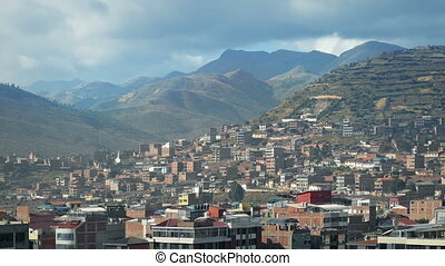 South American City With Large Hills In The Background -...