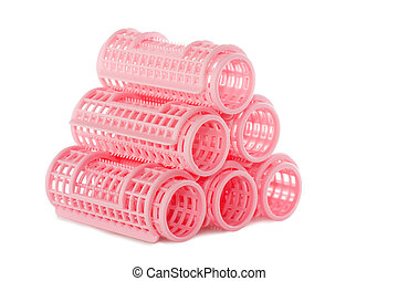 Pink hair rollers - A stack of pink hair rollers isolated...