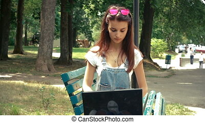 young girl with glasses on head on laptop prints -...