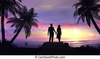 Couple on the tropical sunset background