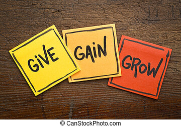 give, gain and grow concept in sticky notes