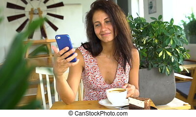 Young girl use smartphone and smile. Chatting with friend
