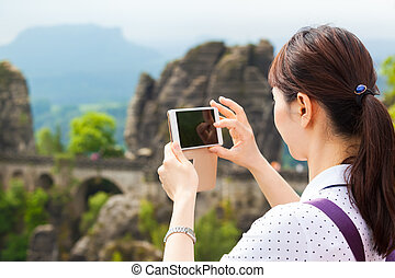 Taking Pictures of Tourist Attraction - Young asian female...