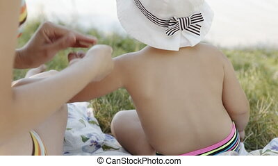 Parent applying cream on child - The anonymous application...