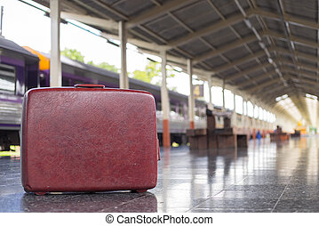 red vintage travel bags at trainstation, travel concept