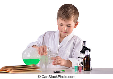 Science boy pours green liquid from flask into glass