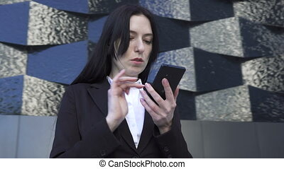 Business woman uses a smartphone