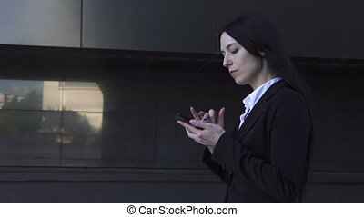 Business woman walking and talking on phone