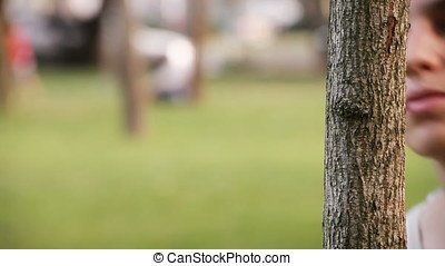 Young Woman Playing with Camera and Tree