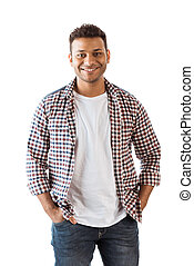 Portrait of handsome young man with hands in pockets smiling at camera