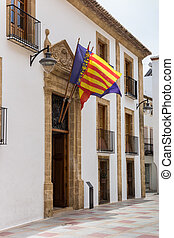 Government building with flags in Javea, Spain