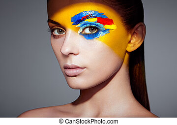 Fashion model woman with colored face painted