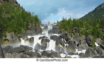 Rainbow at Uchar waterfall, Altai, Russia. The height of the...