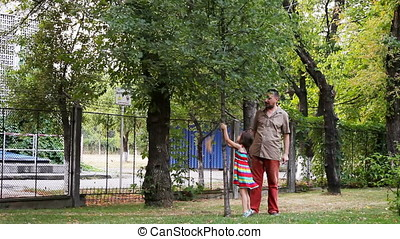 Little Girl Shaking the Tree Getting Plush Toy Back - Little...