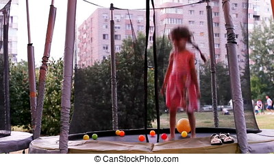 Happy Bouncing Girl On Trampoline And Falling On Bed At...