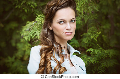 young beautiful woman with long hair in the park