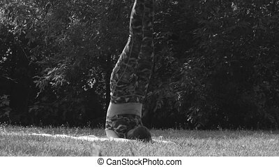 Young woman doing yoga exercises - Black and white. Young...