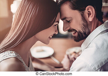 Couple in love in cafe - Beautiful couple in love is sitting...