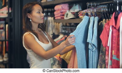 Beautiful businesswoman buying clothes. Close up....