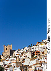 White houses and castle tower of Alcala del Jucar, Spain