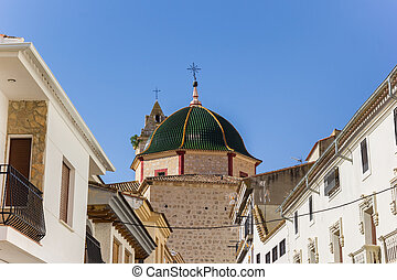 Green tiled dome of the church in Alcala del Jucar, Spain