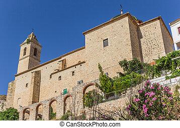 Historic church in the center of Alcala del Jucar, Spain