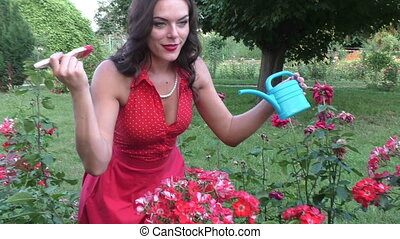 Woman in a flower garden. - Woman in a flower garden, she...