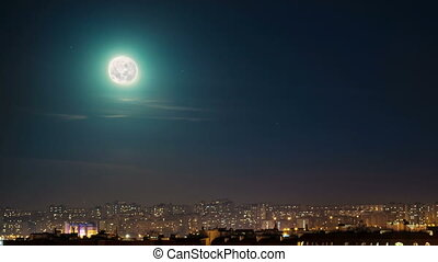 Moon over city, time lapse