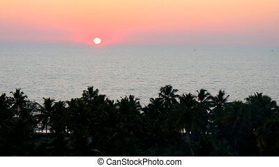 Tropical sunset over Bay of Bengal, Goa. Place of romantic...