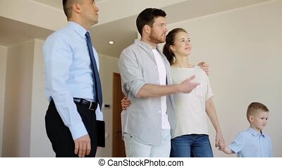 happy family and realtor at new house or apartment -...
